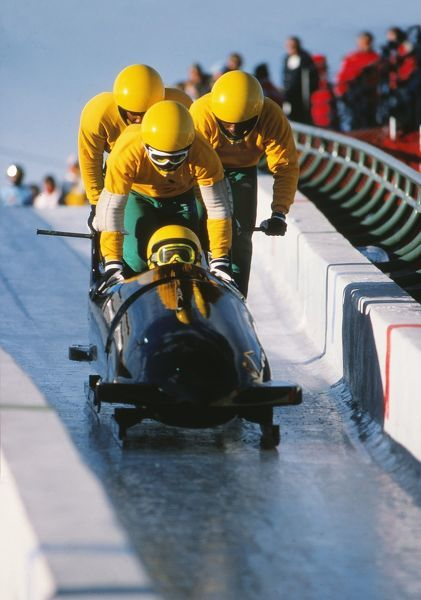 Bobsleigh - 1988 Calgary Winter Olympics - Men's Four Training The Jamaica team - Dudley Stokes, Devon Harris, Michael White, Chris Stokes - during the start phase in training at the Canada Olympic Park, Calgary