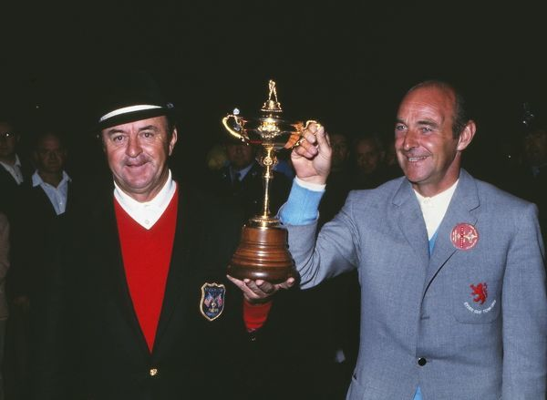 Golf - 1969 Ryder Cup - Great Britain & Ireland 16 USA 16 (USA retains trophy) USA captain Sam Snead (left) and GB captain Eric Brown hold the Ryder Cup after the contest is drawn 16-all at Royal Birkdale