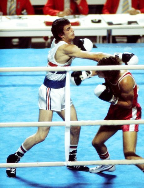 Boxing - 1976 Montreal Olympics Men's Flyweight Round Three - Ian Clyde vs. Charlie Magri Great Britain's Charlie Magri (left) on the way to losing to Canada's Ian Clyde in the Maurice Richard Arena, Quebec, Canada
