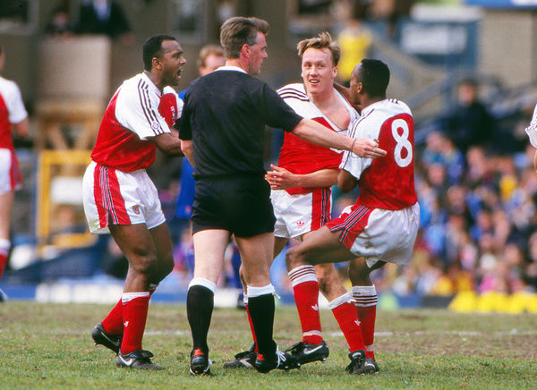 Football - 1991 / 1992 First Division - Chelsea 1 Arsenal 1     Arsenal's Lee Dixon celebrates his goal with David Rocastle and Ian Wright, at Stamford Bridge.     25/04/1992
