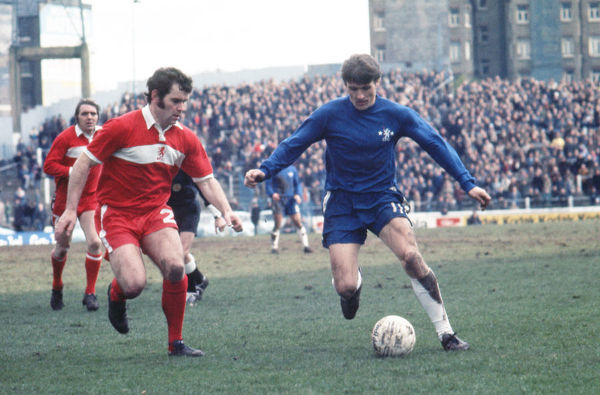 Football - 1974 / 1975 First Division - Chelsea 1 Middlesbrough 2    Charlie Cooke on the ball for Chelsea, under pressure from John Craggs, at Stamfords Bridge.    22/03/1975