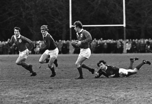 Rugby Union - 1968 / 1969 season - London Welsh vs. London Scottish  Cliff Yorath of London Welsh on the ball, with teammate John Dawes in support, far left, at Old Deer Park. 25/01/1969