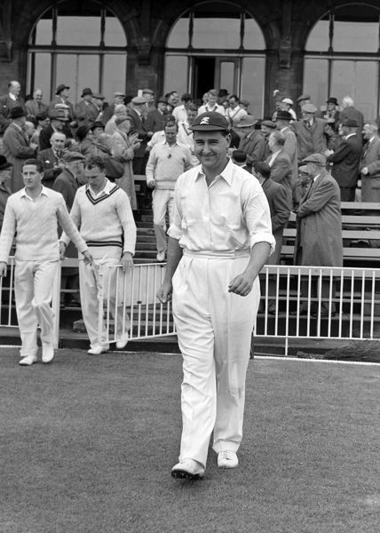 Cricket - Colin Cowdrey - Kent leads the players onto the field. 1957 Credit: Colorsport