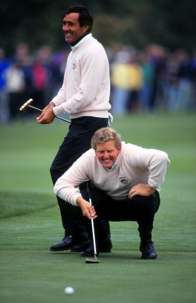 Golf - 1993 Ryder Cup - The Belfry Europe's Colin Montgomerie lines up a putt, to the amusement of his playing partner Severiano 'Seve' Ballesteros. The USA retained the Cup by beating Europe by 15 points to 13