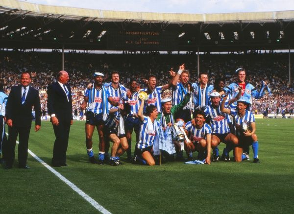 Football - 1987 FA Cup Final - Tottenham Hotspur 2 Coventry City 3 (a.e.t.) The Coventry team celebrate their victory with manager John Sillett and assistant George Curtis, far left
