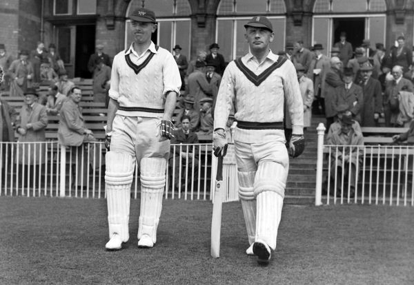 Cricket - 1947 season Cyril Washbrook, right, walks out to bat with Winston Place for Lancashire