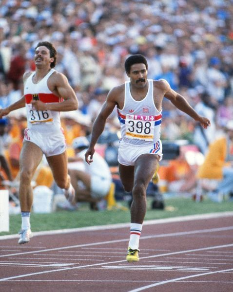 Athletics - 1984 Los Angeles Olympics - Men's Decathlon Day 1 Great Britain's Daley Thompson crosses the line in the 400m event ahead of West Germany's Jurgen Hingsen, left in the Los Angeles Memorial Coliseum, California, USA