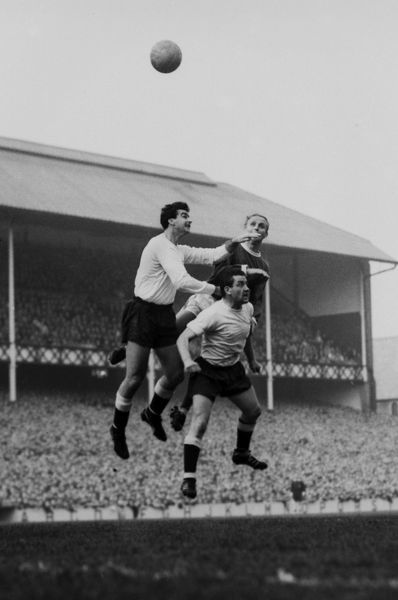 Football - 1963 / 1964 First Division - Everton 1 Tottenham Hotspur 0 Spurs' Dave Mackay and Maurice Norman jump for the ball with Everton's Alex Young at Goodison Park