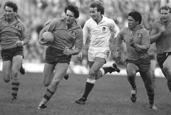 DAVID CAMPESE (AUS) goes over for his try as Mark Ella and Robert Lozowski (Eng) look on.  ENGLAND V AUSTRALIA, 03/11/1984 TWICKENHAM  CREDIT : COLORSPORT