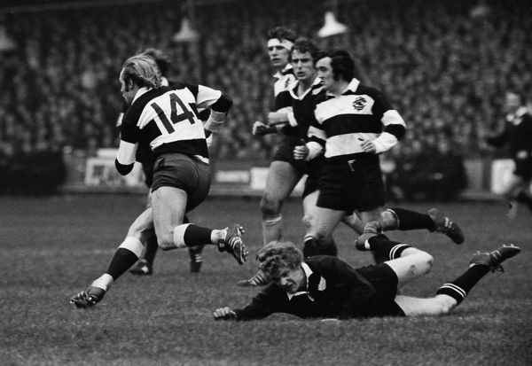 Rugby Union - 1972 / 1973 New Zealand Tour of Great Britain & France - Barbarians 23 New Zealand 11 David Duckham (#14) makes another break for the Barbarians at Cardiff Arms Park, with teammate Phil Bennett, right
