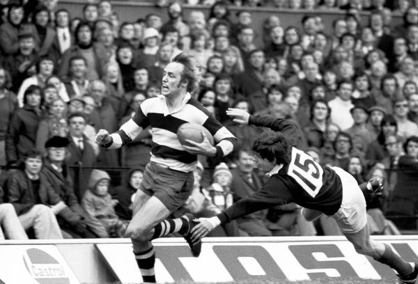 Rugby Union - 1974 RFU Club Knockout Cup Final - Coventry 26 London Scottish 6 Coventry captain David Duckham makes a break past the Scottish full back on the way to scoring two tries during the game at Twickenham