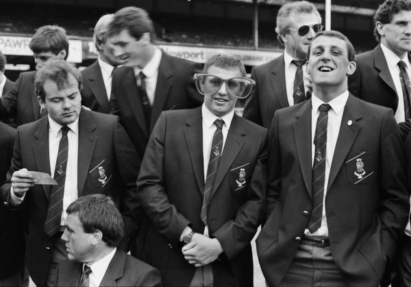 Rugby Union - England squad training session @- Twickenham 1987 Dean Richards jokes around with a large pair of glasses with team mate Wade Dooley before the team group