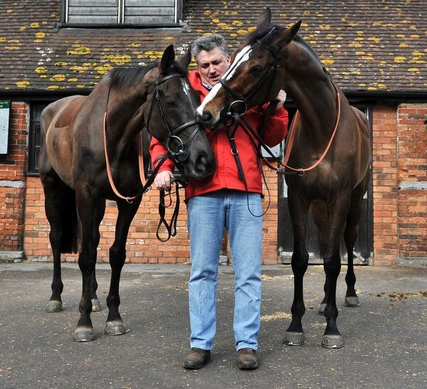 Horse Racing Paul Nicholls Stable Media Visit and Cheltenham Festival Entry Preview 24/02/2010.  Credit: Dan Rowley/Colorsport Paul Nicholls with Gold Cup entries Kauto Star (right) and Denman (left)