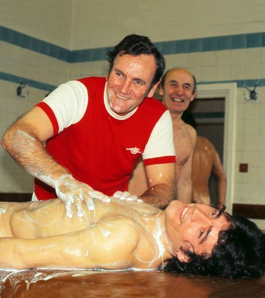Don Revie - England manager (with Arsenal shirt on ) gives Kevin Keegan a body massage after England training @ the Arsenal football club, Highbury 1976 / 77 season Credit : Colorsport / Andrew Cowie