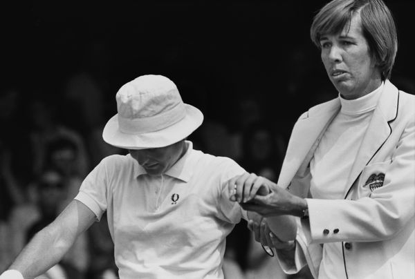 Tennis - 1970 Wightman Cup - Wimbledon US team manager Doris Hart helps the injured Nancy Richey from the court. The USA beat Great Britain 4-3. 14/06/1970