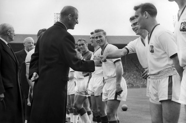 Duncan Edwards is introduced to Prince Philip, The Duke of Edinburgh before kick off. Bobby Charlton (centre) Eddie Colman (right).  FA Cup Final 1957 04/05/1957 @ Wembley; Aston Villa v Manchester United  Credit: Colorsport