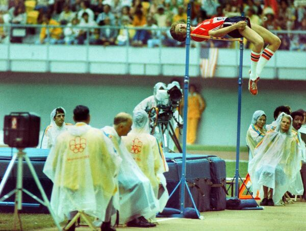 Athletics - 1976 Montreal Olympics - Men's High Jump The USA's Dwight Stones jumps in the rain in the Olympic Stadium, Quebec, Canada. Although a heavy favourite for the gold, Stones would win the bronze medal
