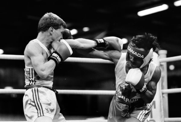 Boxing - 1986 Edinburgh Commonwealth Games - Men's Flyweight [51kg] Semi-Final: John Lyon (England) vs. Steve Beaupre (Canada) John Lyon on the attack. Lyon went on to win the gold medal and Beaupre a bronze