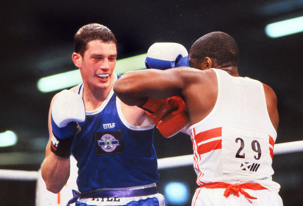 Boxing - 1986 Edinburgh Commonwealth Games - Heavyweight [91kg] Semi-Final: Eric Cardouza (England) vs Douggie Young (Scotland) Douggie Young on the way to victory. Cardouza won a bronze medal and Young the silver