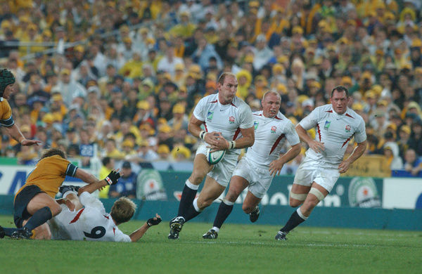 Rugby Union - The 2003 World Cup Final - England 20 Australia 17 (a.e.t.)    The England back row on the charge. Left to right: Lawrence Dallaglio, Neil Back and Richard Hill.    Telstra Stadium (now Stadium Australia), Sydney, Australia