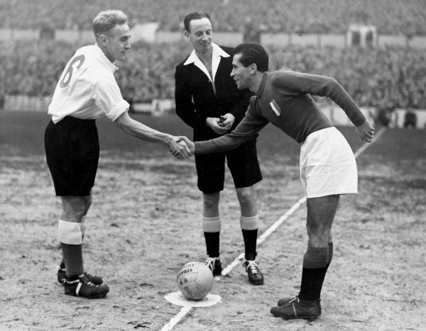 Football - 1949 / 1950 International Friendly - England 2 Italy 0 Billy Wright, England captain, and Carapellese, Italy's captain shaking hands before the international kicked off at White Hart Lane. Centre is the referee, J A. Mowatt (Scotland)