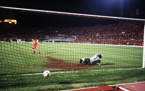 Football - 1984 European Cup Final - Liverpool 1* Roma 1 (*won 4-2 on pen a.e.t.)     The penalty shoot-out, at the Stadio Olimpico, Rome.     Seventh kick. Goalkeeper Franco Tancredi. Liverpool's Ian Rush scores; score 3-2.     30/05/1984