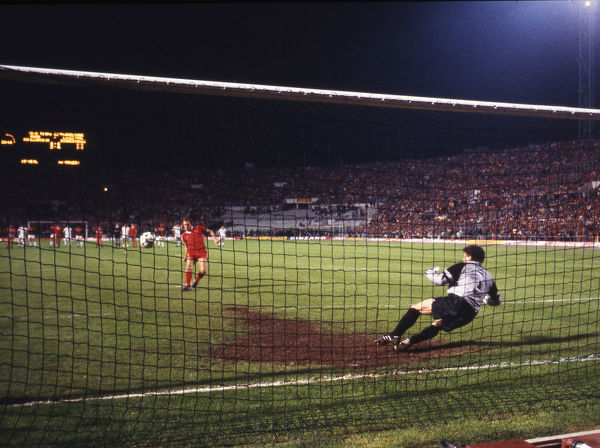 Football - 1984 European Cup Final - Liverpool 1* Roma 1 (*won 4-2 on pen a.e.t.)   The penalty shoot-out, at the Stadio Olimpico, Rome.   Third kick. Goalkeeper Franco Tancredi. Liverpool's Phil Neal scores; score 1-1.   30/05/1984
