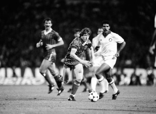 Football - 1984 European Cup Final - Liverpool 1* Roma 1 (*won 4-2 on pen a.e.t.)   Liverpool's Steve Nicol on the ball ahead of Toninho Cerezo, at the Stadio Olimpico, Rome.   30/05/1984