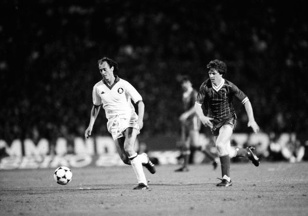 Football - 1984 European Cup Final - Liverpool 1* Roma 1 (*won 4-2 on pen a.e.t.)   Liverpool's Steve Nicol challenges Roma's Paulo Roberto Falcao at the Stadio Olimpico, Rome.   30/05/1984