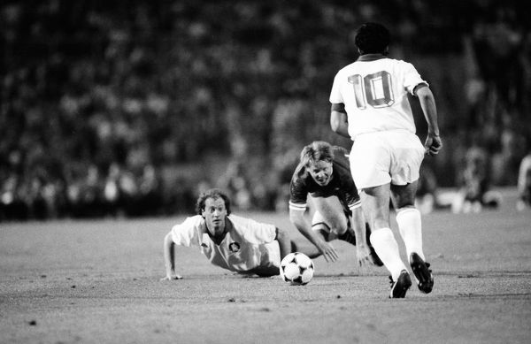 Football - 1984 European Cup Final - Liverpool 1* Roma 1 (*won 4-2 on pen a.e.t.)   Roma's Paulo Roberto Falcao and Liverpool's Sammy Lee fall as Agostino Di Bartolemi (#10) goes for the ball at the Stadio Olimpico, Rome.   30/05/1984