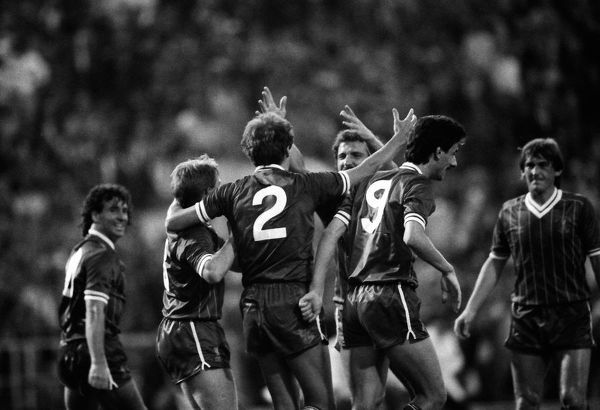Football - 1984 European Cup Final - Liverpool 1* Roma 1 (*won 4-2 on pen a.e.t.)   Liverpool's Phil Neal (#2) celebrates his goal with Sammy Lee (under arm) and Graeme Souness, at the Stadio Olimpico, Rome. Ian Rush (#9), Craig Johnston (far left)