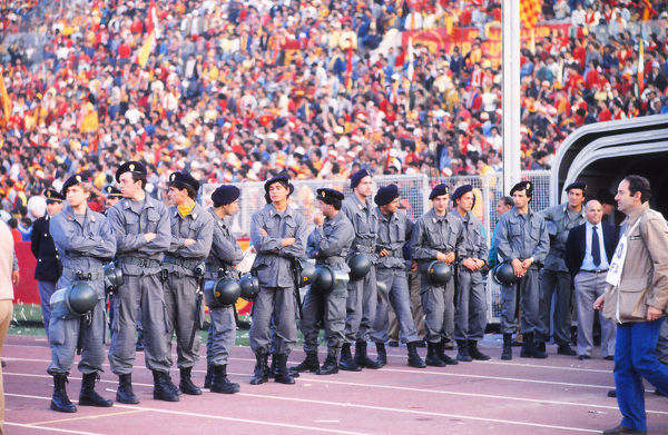 Football - 1984 European Cup Final - Liverpool 1* Roma 1 (*won 4-2 on pen a.e.t.)     Security presence by the tunnel before the players come out for kick-off, at the Stadio Olimpico, Rome.     30/05/1984