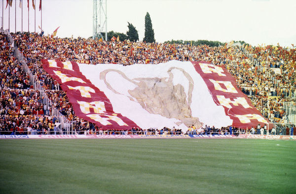 Football - 1984 European Cup Final - Liverpool 1* Roma 1 (*won 4-2 on pen a.e.t.)     Roma fans unfurl a huge banner before kick-off, at the Stadio Olimpico, Rome.     30/05/1984