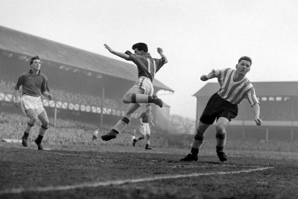 Football - 1955 / 1956 First Division - Everton 1 Sunderland 2     Everton's Graham Williams (#11) leaps for the ball during his debut for the club, with Sunderland's John 'Jack' Hedley, right, at Goodison Park.     10/03/1956
