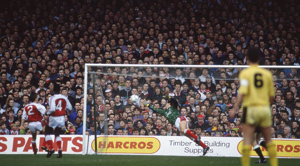 Football - 1990 / 1991 FA Cup - Sixth Round: Arsenal 2 Cambridge United 1     Dion Dublin directs the ball over David Seaman's head to equalise for Cambridge, at Highbury. (seq 2 of 5)     09/03/1991