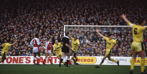 Football - 1990 / 1991 FA Cup - Sixth Round: Arsenal 2 Cambridge United 1     Dion Dublin celebrates scoring the equaliser for Cambridge, at Highbury. (seq 3 of 5)     09/03/1991