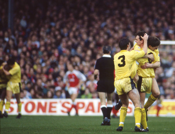 Football - 1990 / 1991 FA Cup - Sixth Round: Arsenal 2 Cambridge United 1     Cambridge celebrates Dion Dublin's equaliser, at Highbury. (seq 5 of 5)     09/03/1991