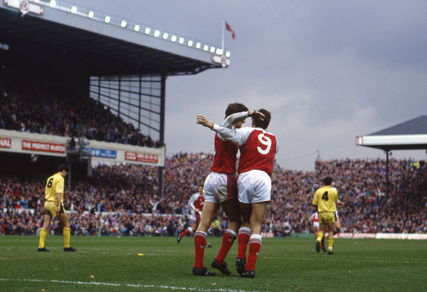 Football - 1990 / 1991 FA Cup - Sixth Round: Arsenal 2 Cambridge United 1     Tony Adams celebrates his winning goal with teammate Alan Smith (#9), at Highbury.     09/03/1991