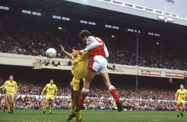 Football - 1990 / 1991 FA Cup - Sixth Round: Arsenal 2 Cambridge United 1     Alan Smith out-jumps Andy Fensome to set up the second Arsenal goal, scored by Tony Adams, at Highbury.     09/03/1991