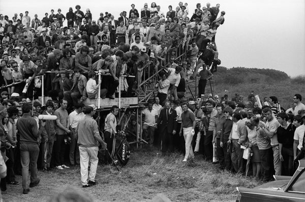 Golf - British Open Golf Championship - Royal Birkdale  Fans clamour for a vantage point in the stands, as Tony Jacklin of Great Britain finds trouble at the first hole