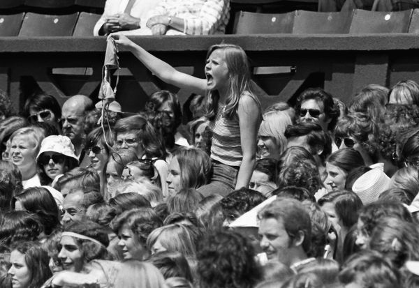 Tennis - Wimbledon Championships 1975 Borg v Riessen. Centre Court. A young female Borg fan offers her bra to Bjorn Borg as he enters Centre Court. Credit : Colorsport / Andrew Cowie