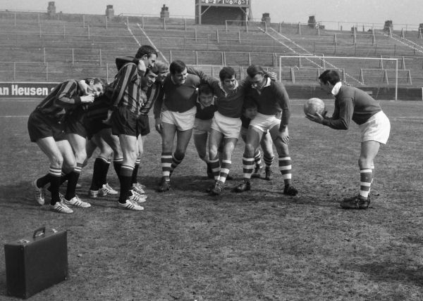 Football meets Rugby League :  Manchester City players Tony Book, Mike Summerbee, Pardoe and Francis Lee, scrum down with some Rugby League players for a pre season photocall