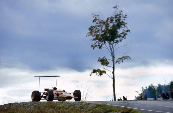 Formula One F1 - USA Grand Prix 1968 Mario Andretti (USA / Lotus Ford)driving past a tree with an extra high aerodynamic wing on his car