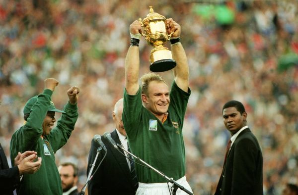 Rugby Union - 1995 World Cup Final - South Africa 15 New Zealand 12 Springbok captain Francois Pienaar lifts the Webb Ellis Cup, as South Africa President Nelson Mandela, left, cheers at Ellis Park, Johannesburg. 24/06/1995