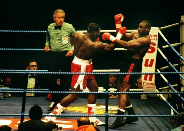 Boxing - 1995 WBC Heavyweight Title Fight - Frank Bruno vs. Oliver McCall Bruno, left, on the attack at Wembley Stadium