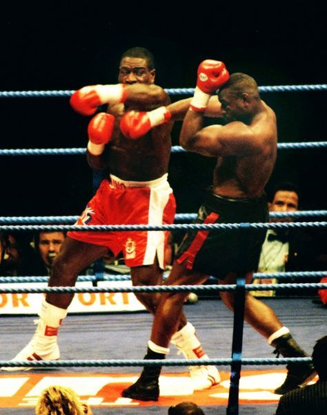 Boxing - 1995 WBC Heavyweight Title Fight - Frank Bruno vs. Oliver McCall Bruno, left, lands a punch at Wembley Stadium