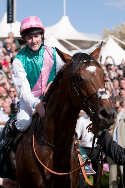 Horse Racing - Ebor Festival 2012 - York Racecourse Frankel, ridden by Tom Queally in the parade ring following victory in the Juddmonte International Stakes