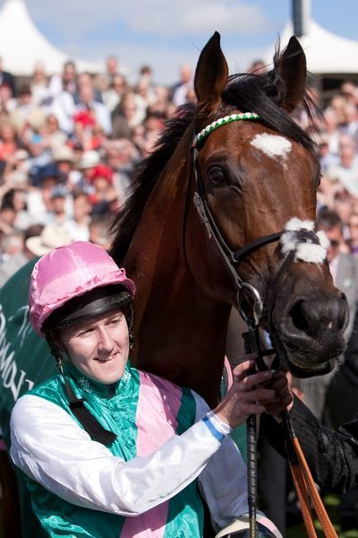 Horse Racing - Ebor Festival 2012 - York Racecourse Jockey Tom Queally and his horse, Frankel in the parade ring following victory in the Juddmonte International Stakes