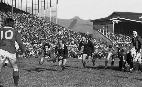 Rugby Union - British Lions Tour of New Zealand 1971, 2nd Test - British Lions vs. New Zealand  Lions scrum-half Gareth Edwards passes to Barry John as the All Blacks Ian Kirkpatrick and Sid Going bear down,during the 2nd test at Lancaster Park