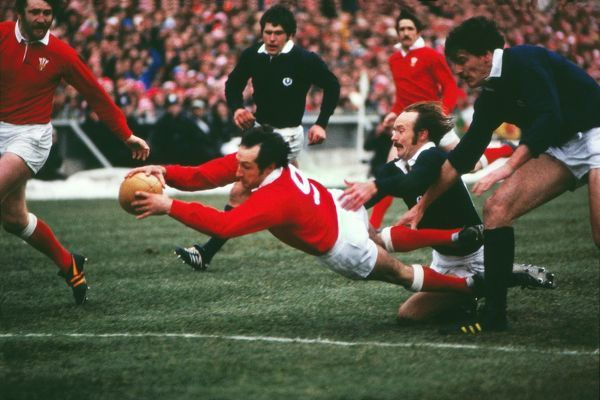 Rugby Union - 1978 Five Nations Championship - Wales 22 Scotland 14 (18/02/1978) Gareth Edwards dives over the try-line at Cardiff Arms Park, as Scotland's Jim Renwick in vain, to score his last ever try for Wales